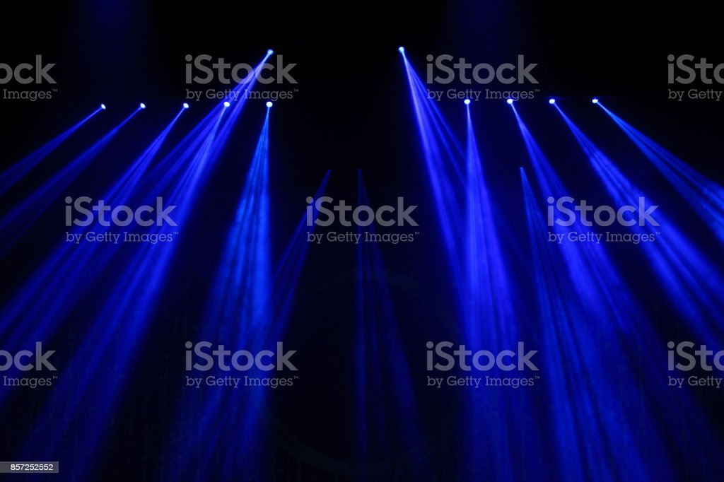 Performance moving lighting on construction light beam ray stock photo