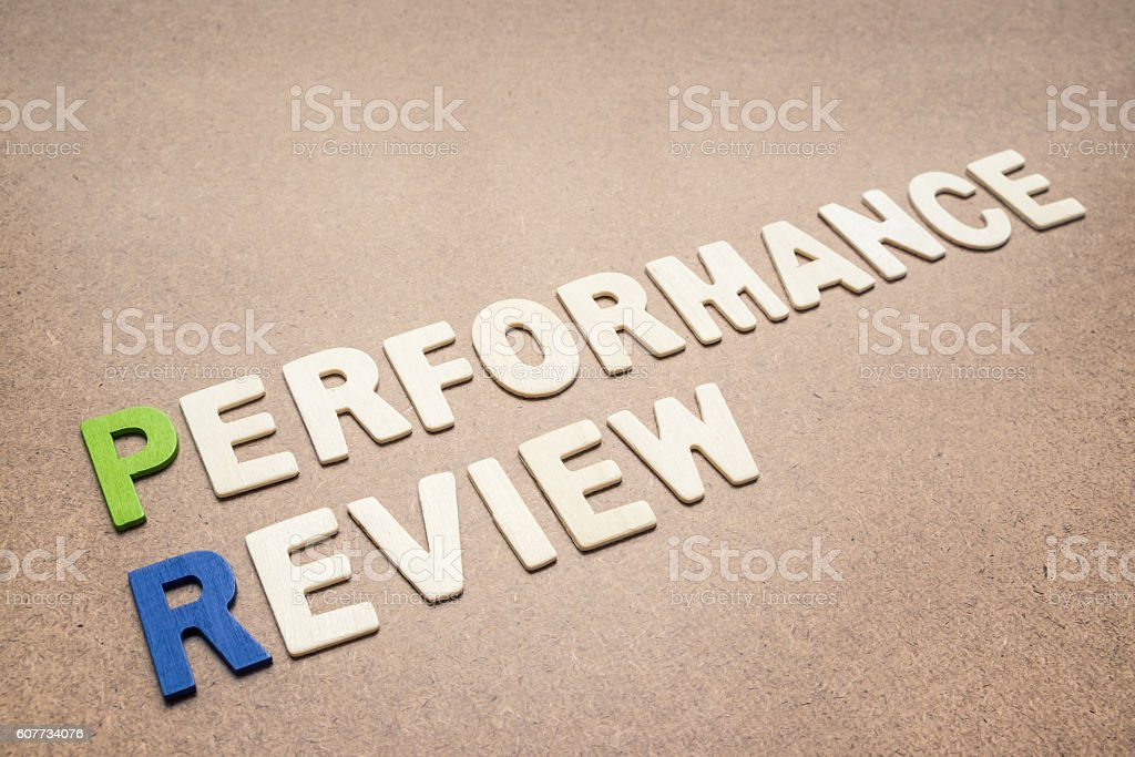 Performance review text on brown background stock photo