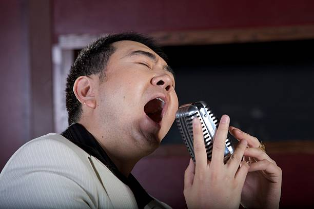 Performer Belting out song stock photo