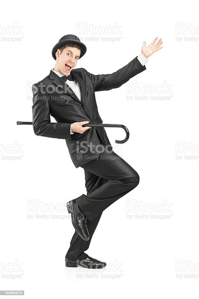 Performer dancing with a cane stock photo