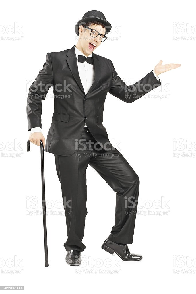 Performer in black suit dancing with a cane stock photo