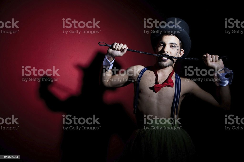 Performer in top hat with whip royalty-free stock photo