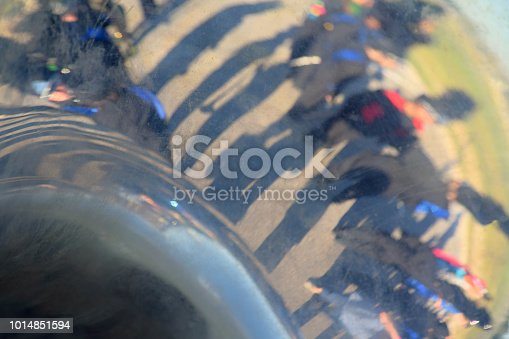 istock Performers and Landscape Beyond Reflected in the Bell of a Brass Sousaphone 1014851594