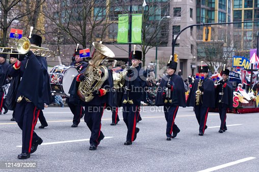 Vancouver, Canada - December 1, 2019: Performers are walking Down the street with Brass Instruments during The Annual Santa Claus Parade