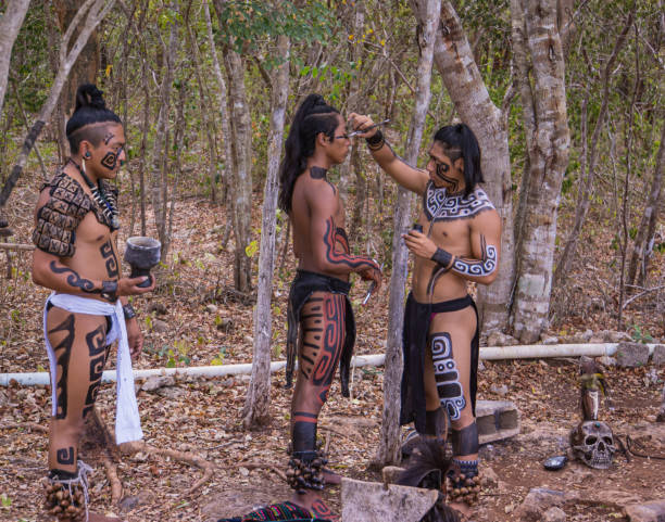 performers getting ready for Mayan ceremony stock photo