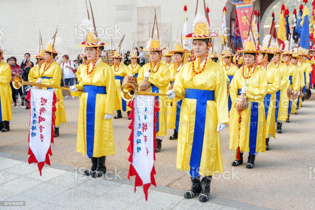 Performers holding horns (nagak and nabal), Gwanghwamun Gate stock photo