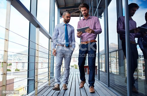 Shot of two young businessmen using a digital tablet together outside of an office buildinghttp://195.154.178.81/DATA/i_collage/pi/shoots/806217.jpg