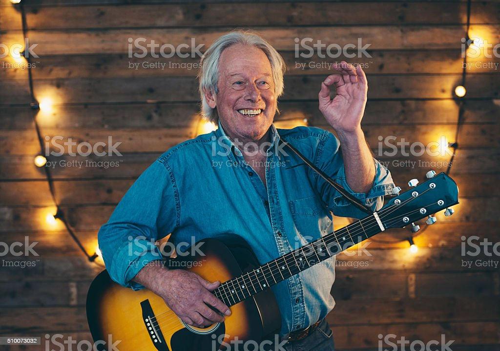 Performing country and western guitarist. stock photo