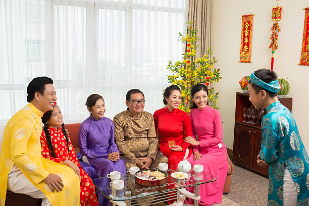performing in front of family - ao dai stock photos and pictures