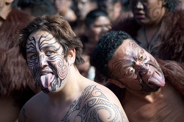 performing the haka - maori stock photos and pictures