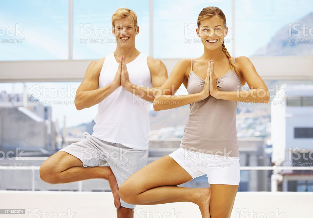 Performing the tree pose happily royalty-free stock photo