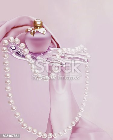 istock Perfume, a string of pearl beads and pink silk scarf is located on a pink background. 898467564