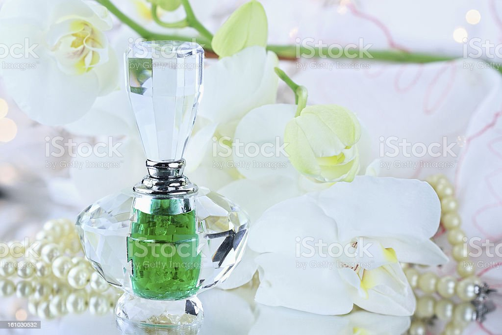 Perfume and white orchids royalty-free stock photo