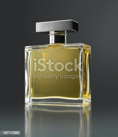 Perfume bottle with reflection on gray background (original flask inspired by several forms)