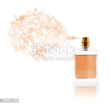 istock Perfume bottle spraying colored scent 1084847780