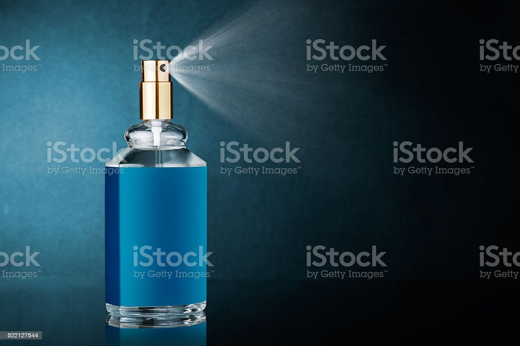 Perfume bottle with spray stock photo