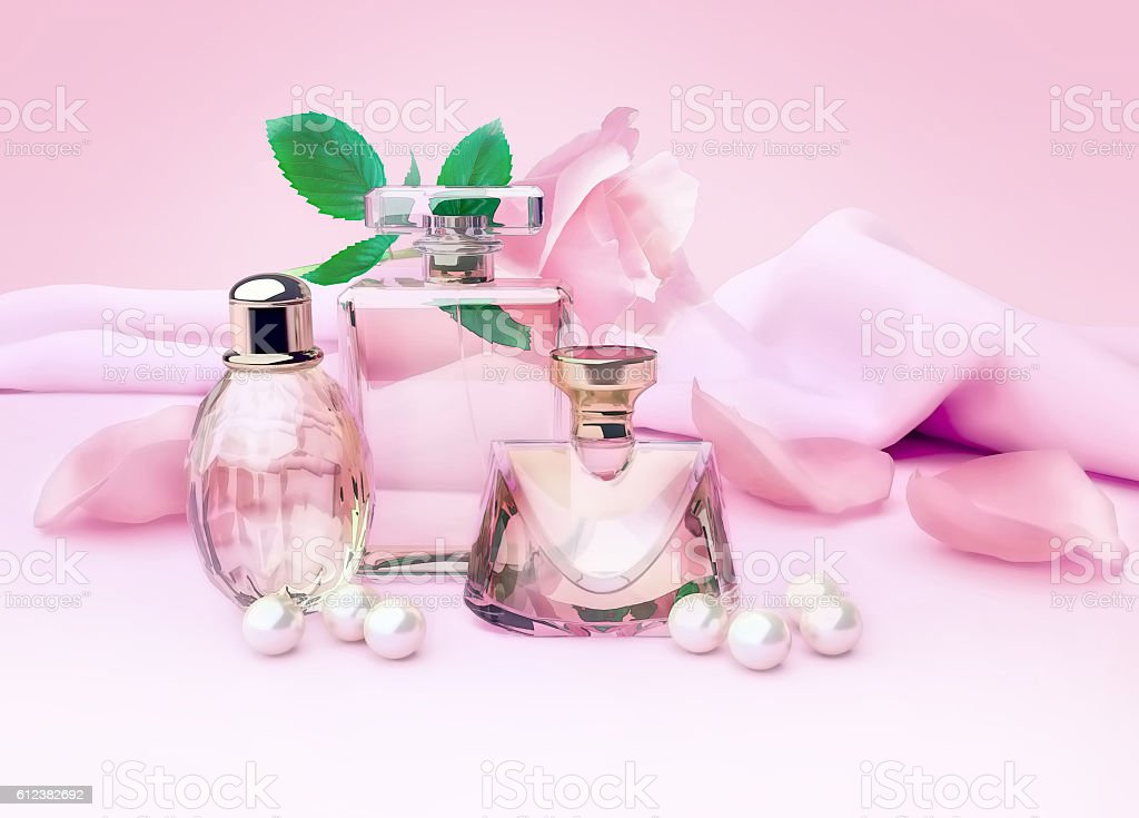 Perfume bottles and flower rose, petals and pearls on pink stock photo