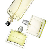Three perfume bottles floating against white background. Clipping path
