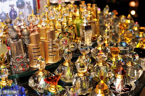 an array of perfume bottles display in a shop, image taken in dubai, a shopping paradise in the meddle east.