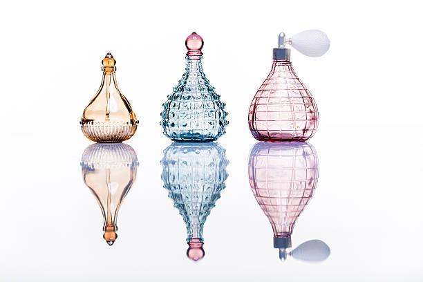 perfume bottles studio shot on white with reflection - parfym bildbanksfoton och bilder