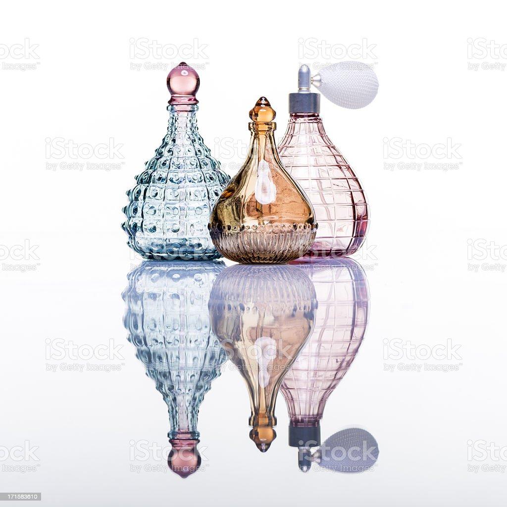 Perfume bottles studio shot on white with reflection stock photo