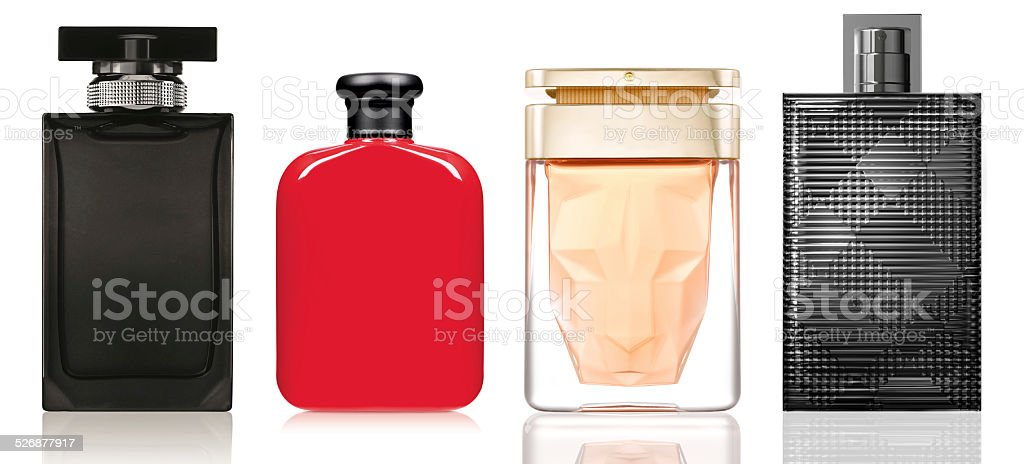 Perfume in a glass bottles on white background stock photo