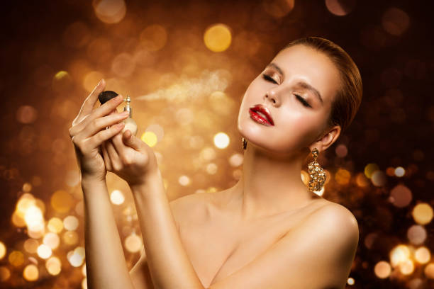 Perfume, Luxury Woman Spraying Fragrance, Aroma and Fashion Model Beauty stock photo
