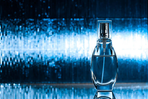 Perfume on blue background stock photo