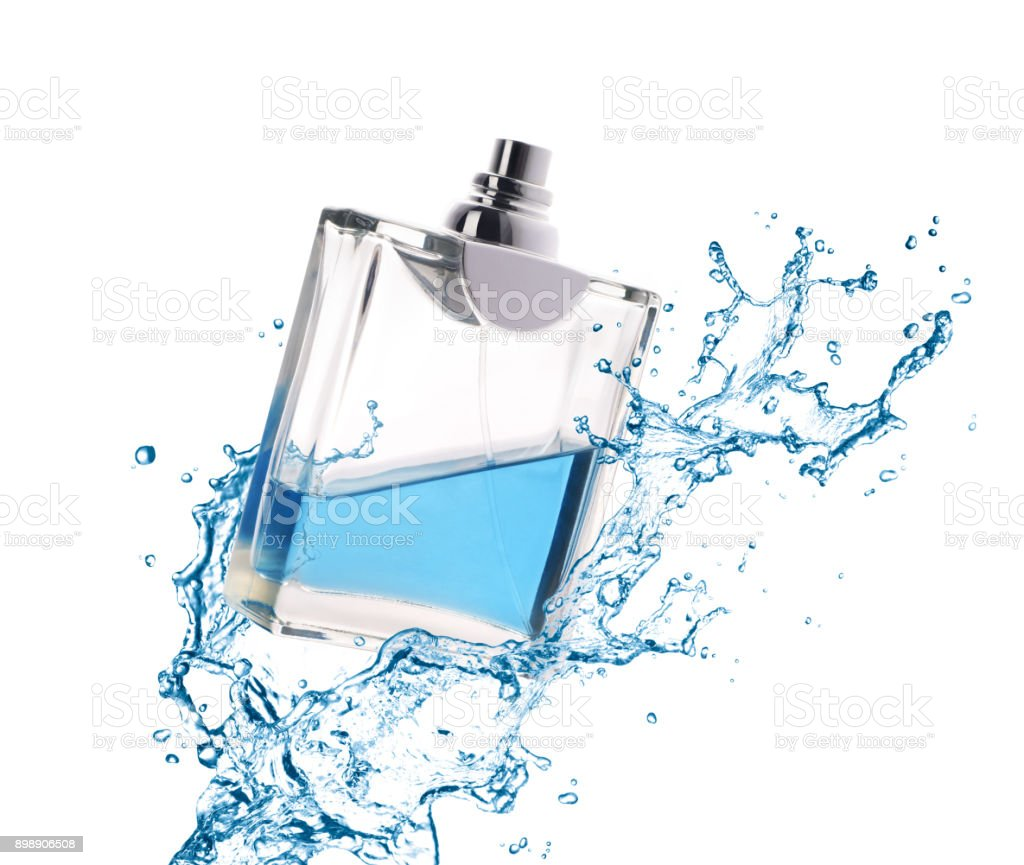 Perfume splashes in the bottle stock photo