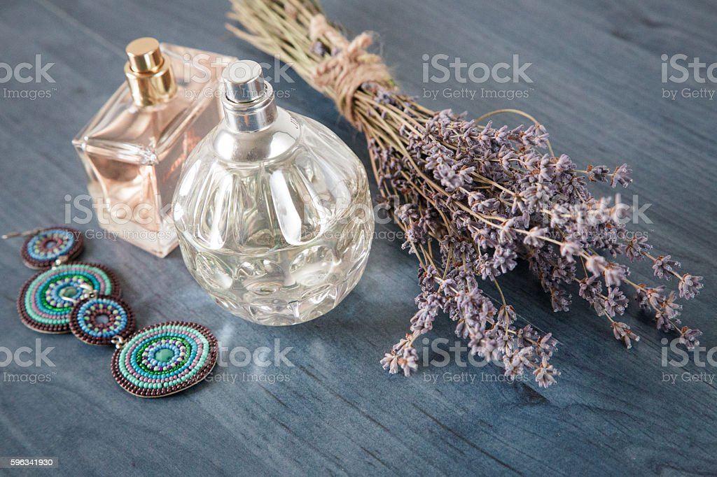 perfume with a bouquet of lavender and jewelry royalty-free stock photo