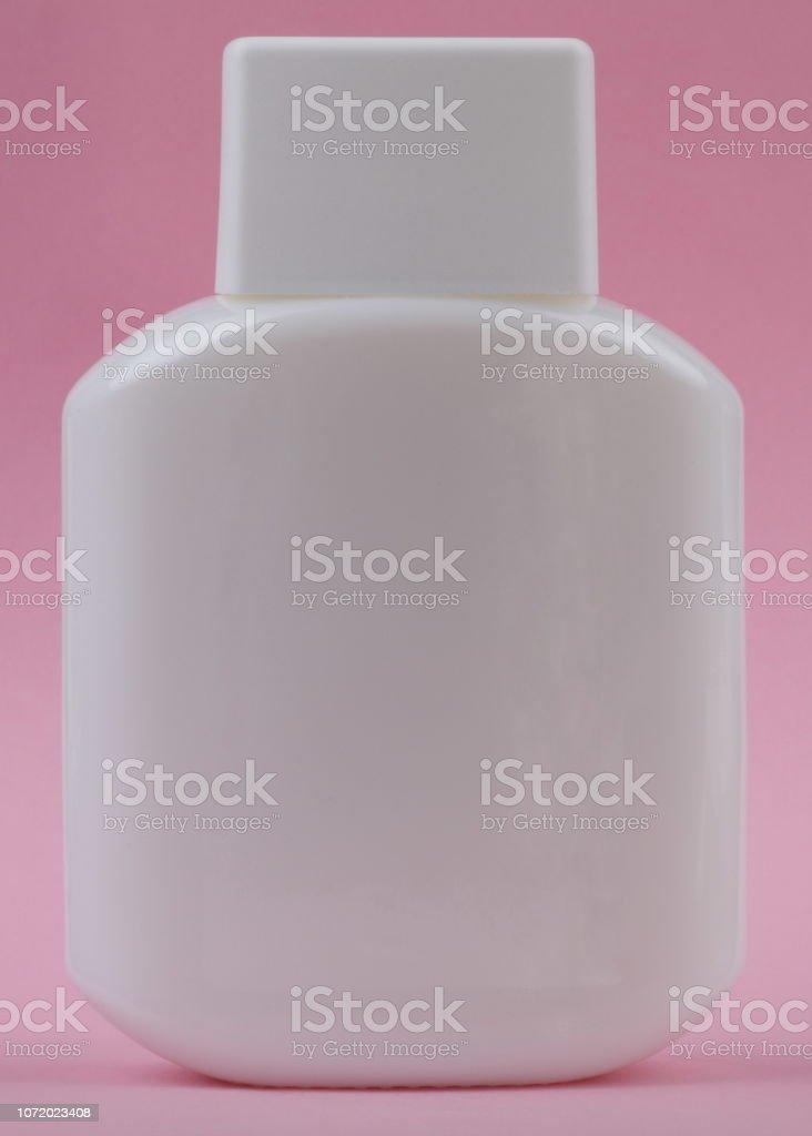 perfumery bottle on pink background stock photo