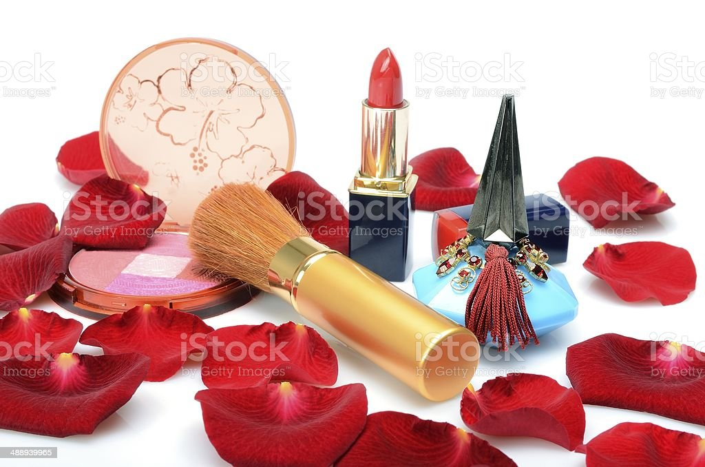Perfumes and decorative cosmetics still life with red rose petals royalty-free stock photo