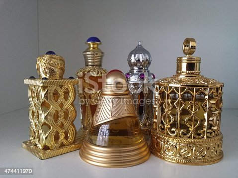 5 exotic arabian-style perfume bottles .