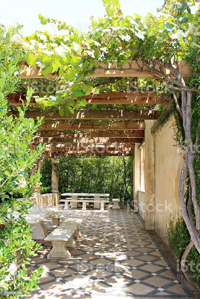 Pergola covered tiled picnic area stock photo
