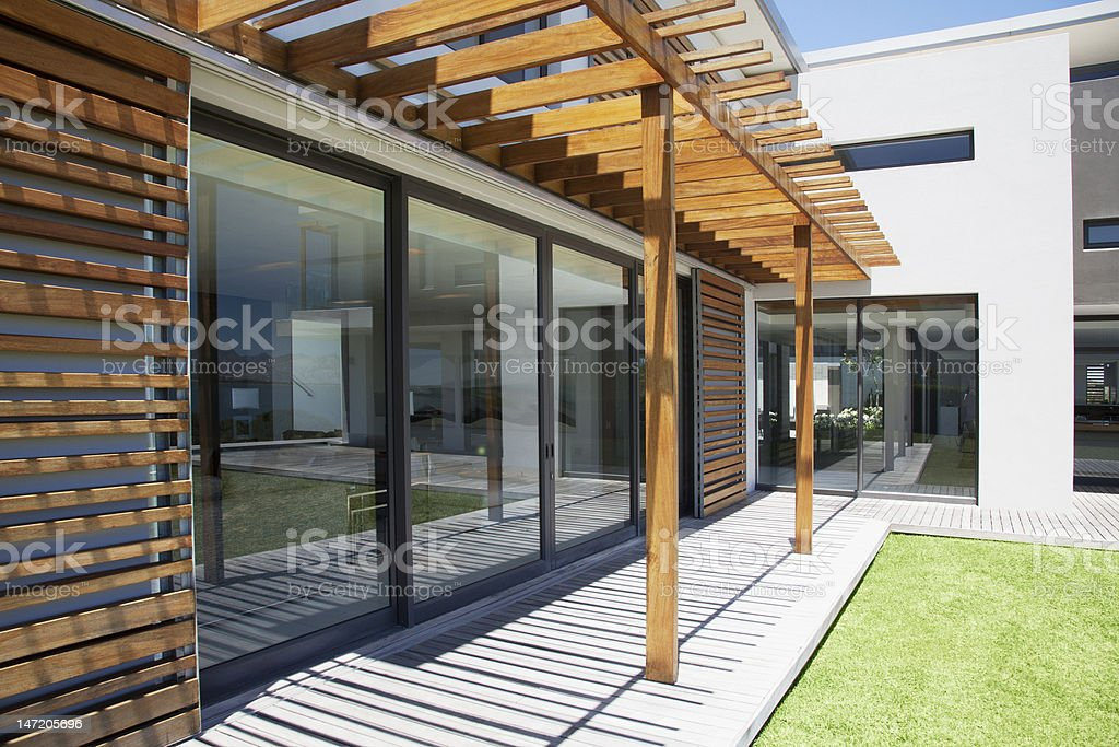 Pergola covering patio of modern house royalty-free stock photo