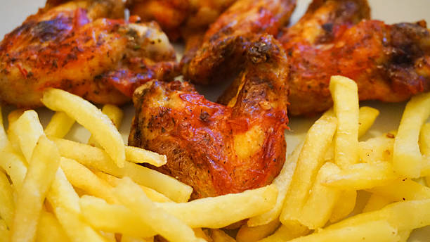 Peri Peri Chicken Wings And Chips stock photo