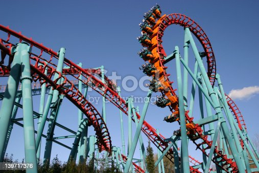 Red roller coaster and big blue sky