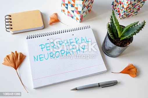 peripheral neuropathy written in a notebook on white table