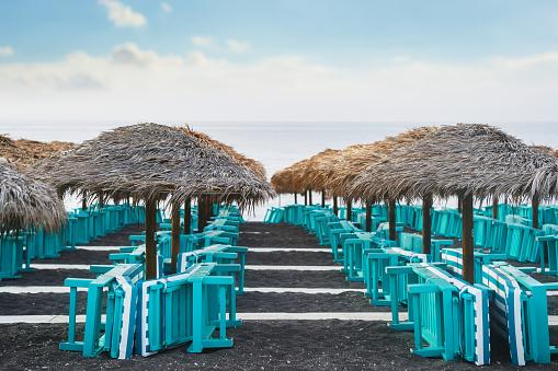View of Perissa black sand beach - Santorini Cyclades island - Aegean sea