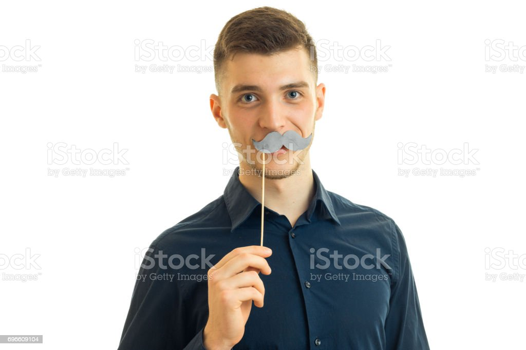 perky young guy with paper mustache stock photo