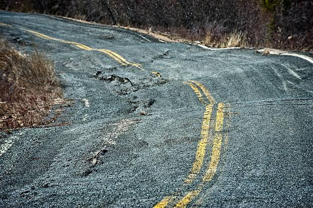 Permafrost damage to a road in the Canadian arctic. stock photo