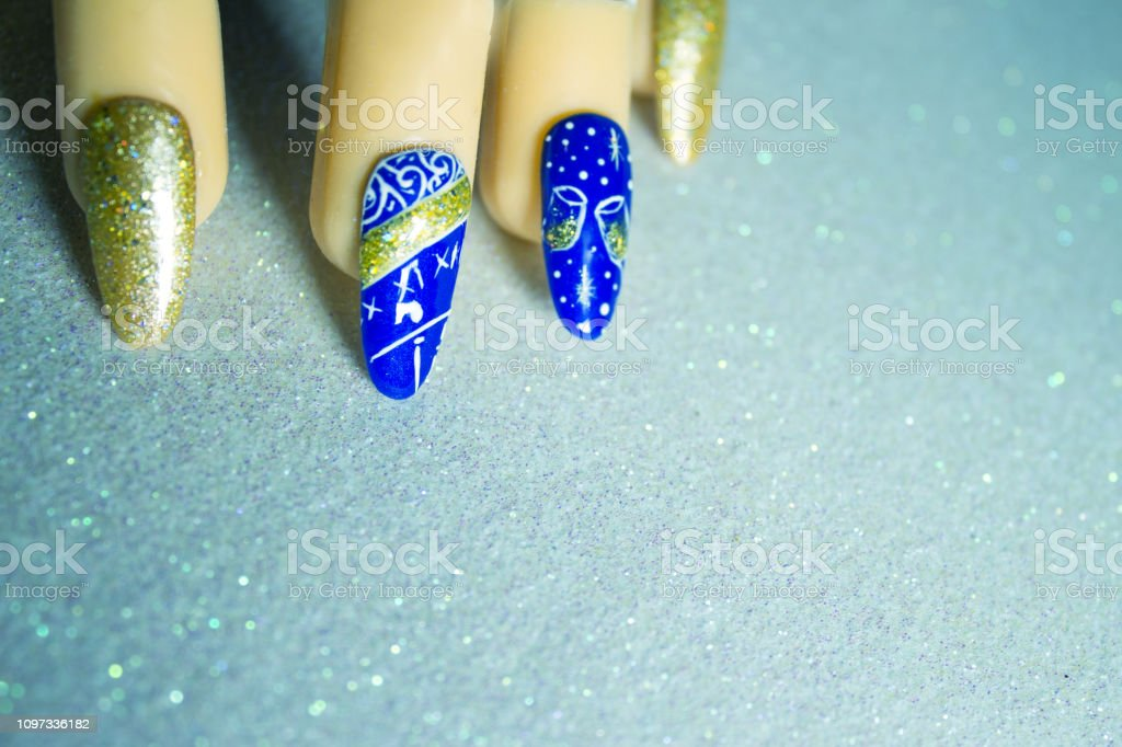 Permanent gel nails with new year decoration. Bright background