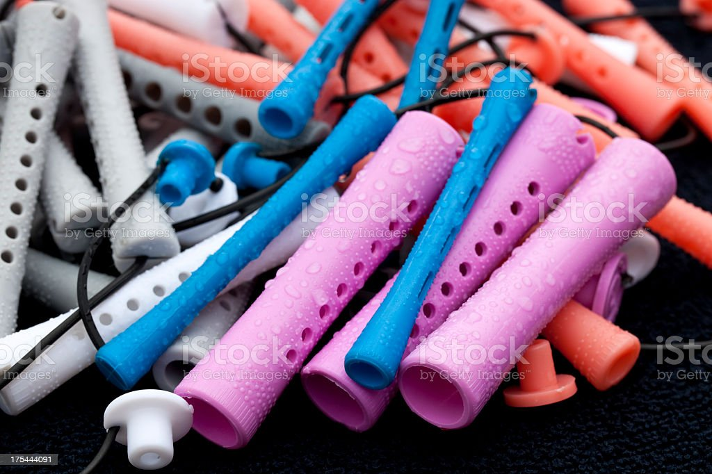 Permanent rollers on blue towel stock photo