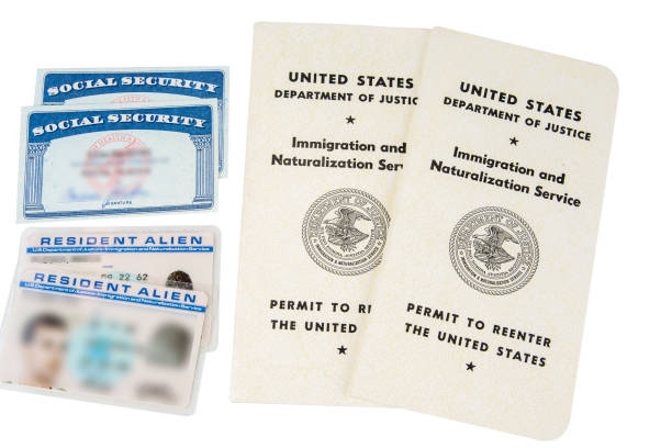 Permit to reenter the United States. Green card .White passport. Social security card Permit to reenter the United States. Green card .White passport. Social security card green card stock pictures, royalty-free photos & images