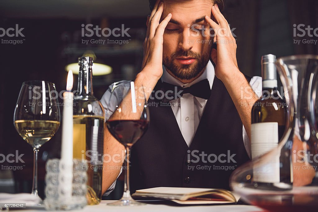 Perplexed adult trying to compose recall stock photo