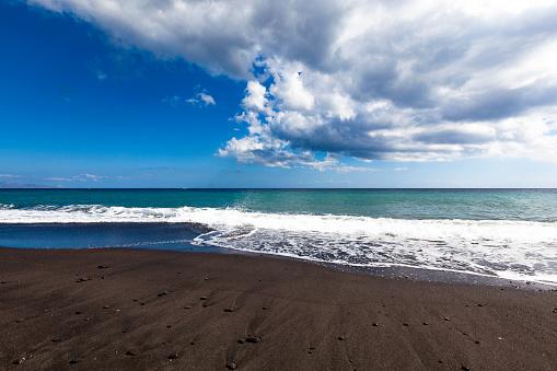 beautiful black sand beach in perrissa on santorini island in greece.