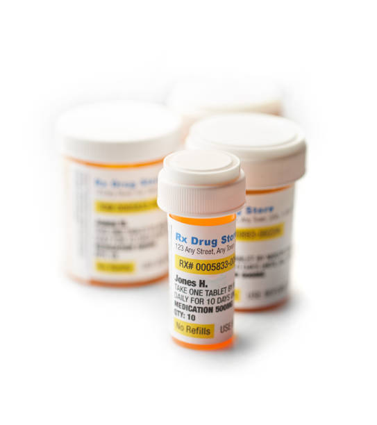 Perscription Medicine on white prescription medicine in bottles ++labels were created by photographer and have been approved by Getty in the past +++ Copyright free +++ pill container stock pictures, royalty-free photos & images