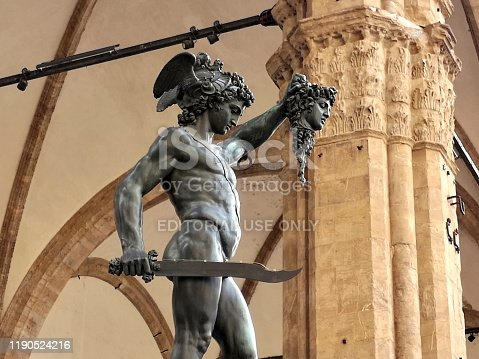 The famous Perseus with the Head of Medusa, a bronze sculpture made by Benvenuto Cellini in 1545, in the Loggia dei Lanzi, on a corner of the Piazza della Signoria in Florence, Italy, adjoining the Uffizi Gallery.