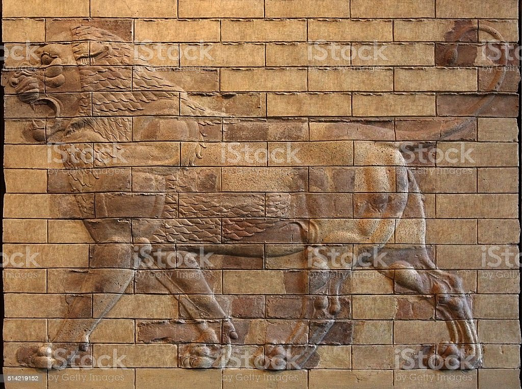 Persian Achaemenid Lion Bas Relief on molded terracotta Bricks stock photo