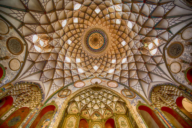 Persian architecture - fresco at ceiling, Iran Typical fresco at a ceiling in a historic persian house using the Persian and Islamic architectural style and decoration. persian culture stock pictures, royalty-free photos & images
